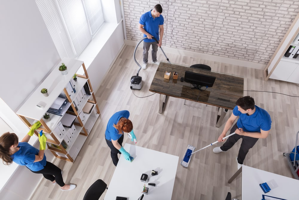 A team of janitors cleaning the office.