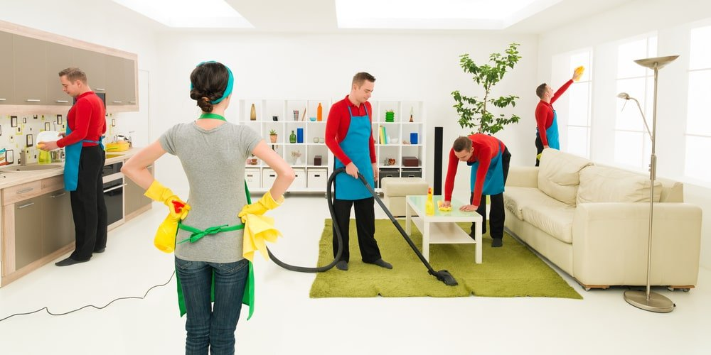 A woman supervising the cleaning of her house.
