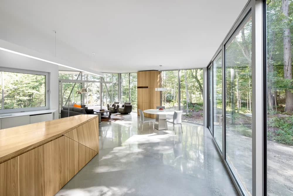 The house also features a great room with glass walls surrounding it.