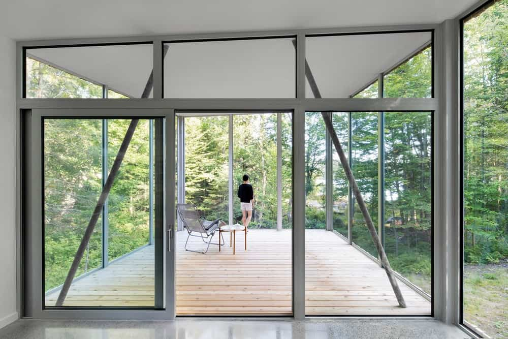 The house also has a vacant room surrounded by floor-to-ceiling glass walls.