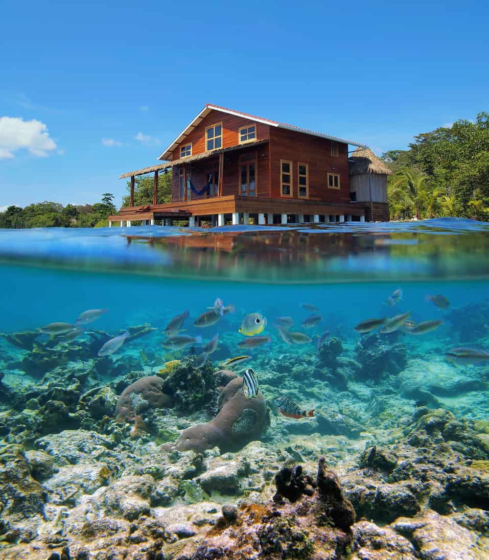 Amazing home built on pilings in the middle of tropical waters.