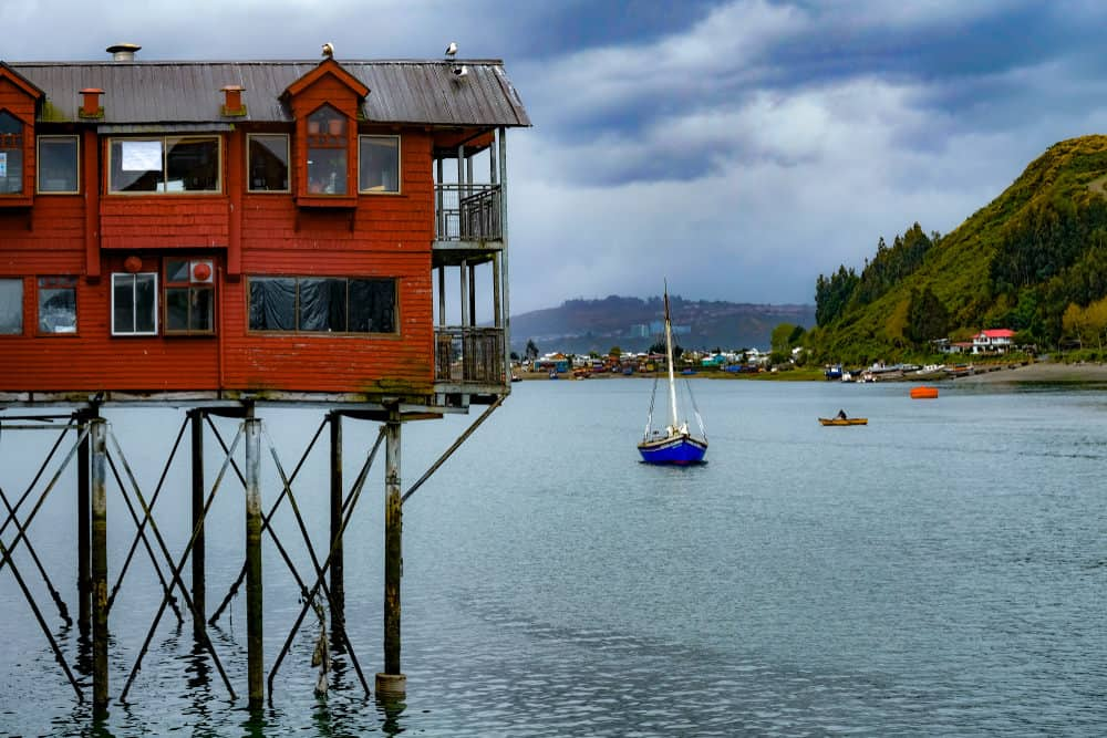 Look how high up that house is built over the water. Looks precarious. It's a nice home too (two stories).