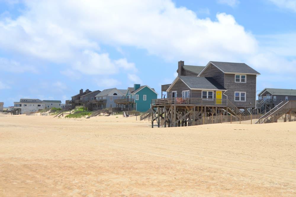 2 story house built on the beach on short stilts.
