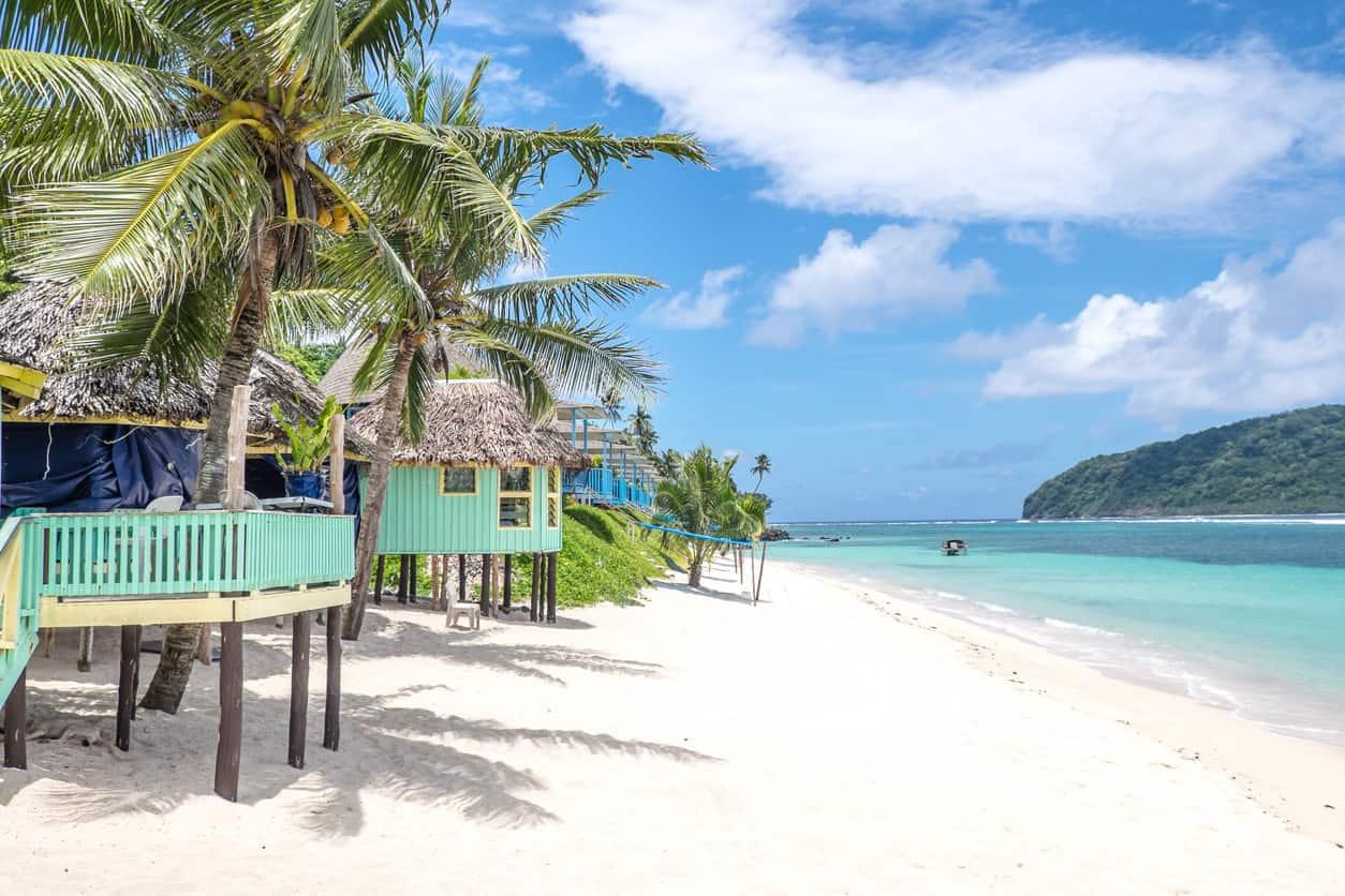 Small huts built on stilts on the beach. Lalomanu Beach, Upolu Island, Samoa