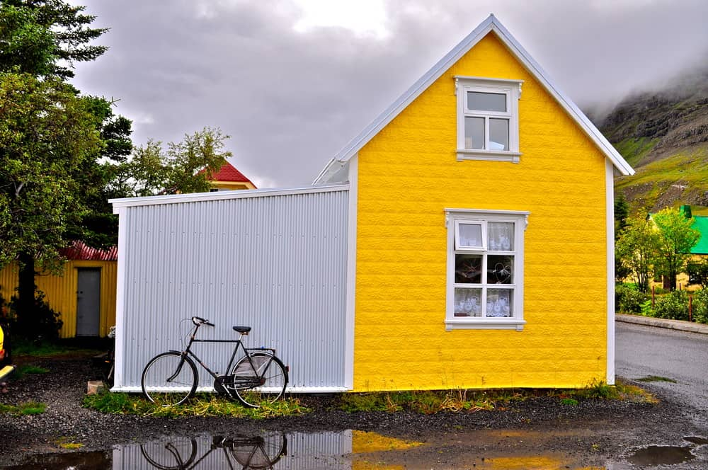 Yellow and light gray house in Iceland. Very simple design, but this older home has a modern, minimalist style to it.
