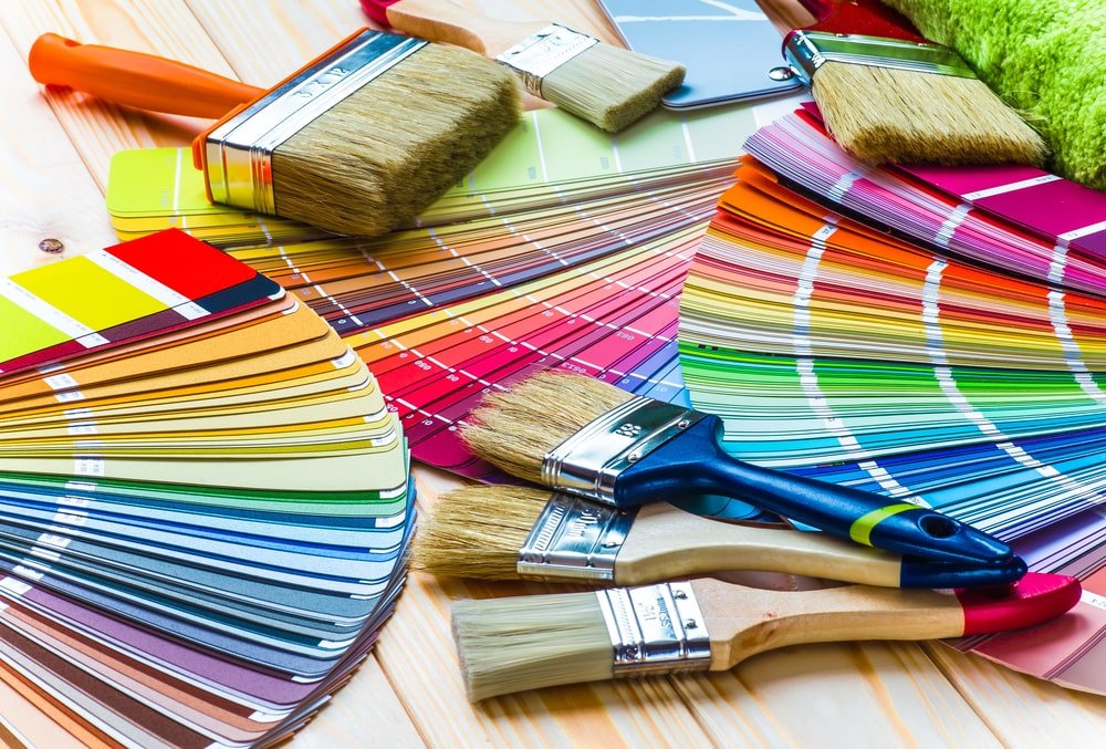 A close look at various paint swatches and paint brushes.