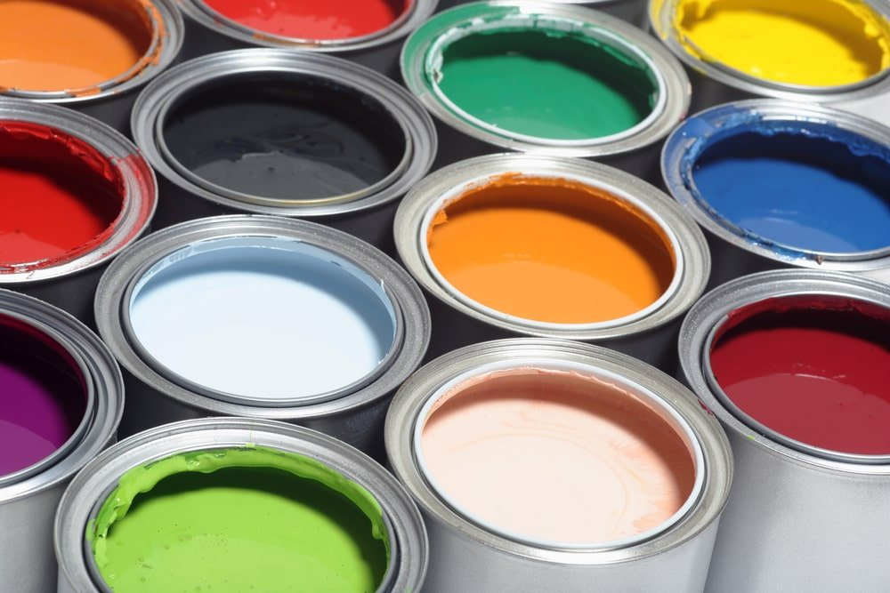 A close look at cans of various paints.