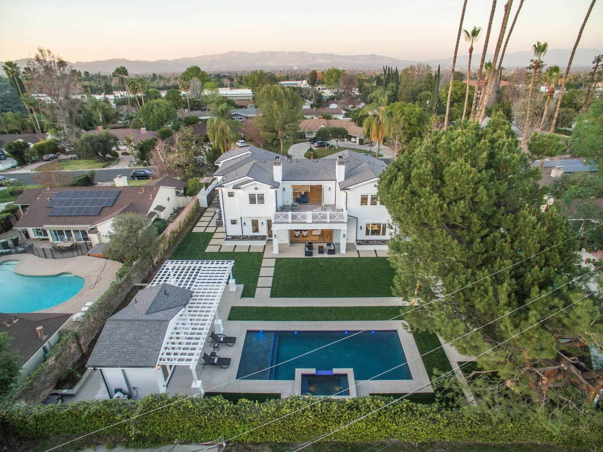 Aerial view of the home featuring the beautiful construction and landscaping of the property.