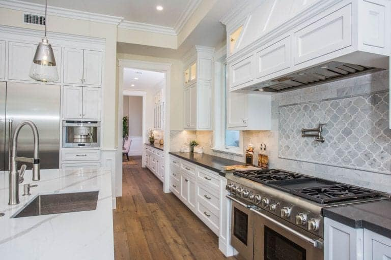 The chefs kitchen offers top-of-the-line appliances and smooth marble countertops.