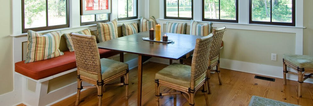 Cozy breakfast nook with windows and bench seating