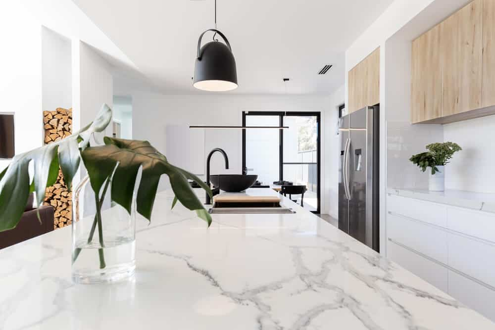 A kitchen with a light marble interior.
