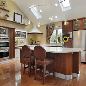 Nice kitchen with shed style ceiling with skylights