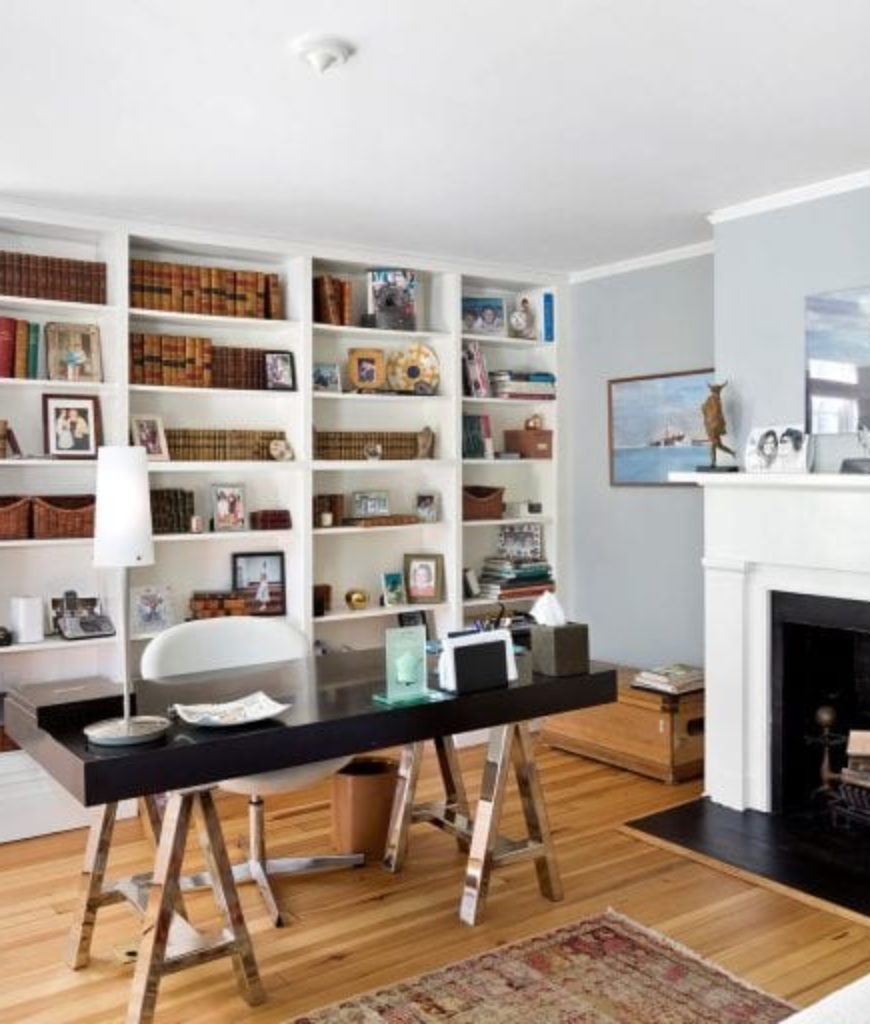 The home also has a home office featuring stylish desk and built-in shelves along with a fireplace.