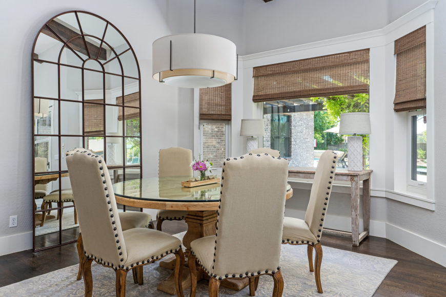 Dining room with round glass-topped table that accommodates 4 people.