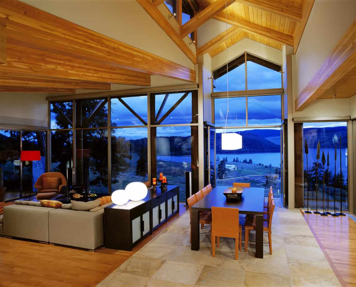 Great room in chalet style home with two story dining room area with view of ocean below. High up on a mountain.