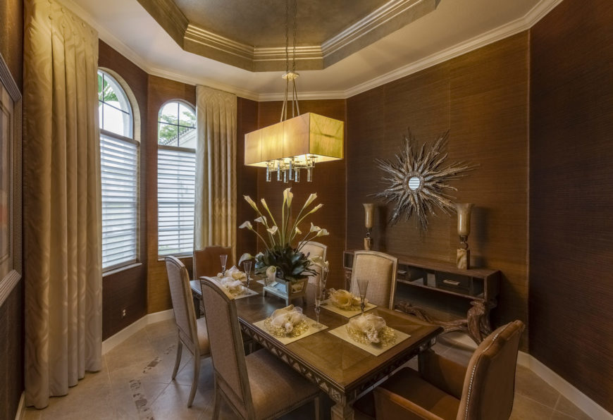 Mediterranean style dining room with white crown molding.
