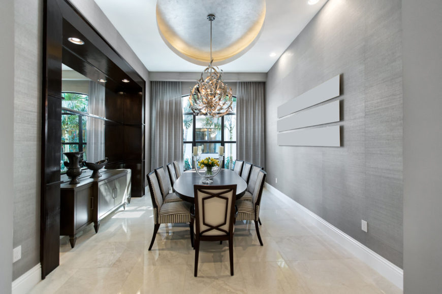 Elegant and contemporary formal dining room with tray ceiling.