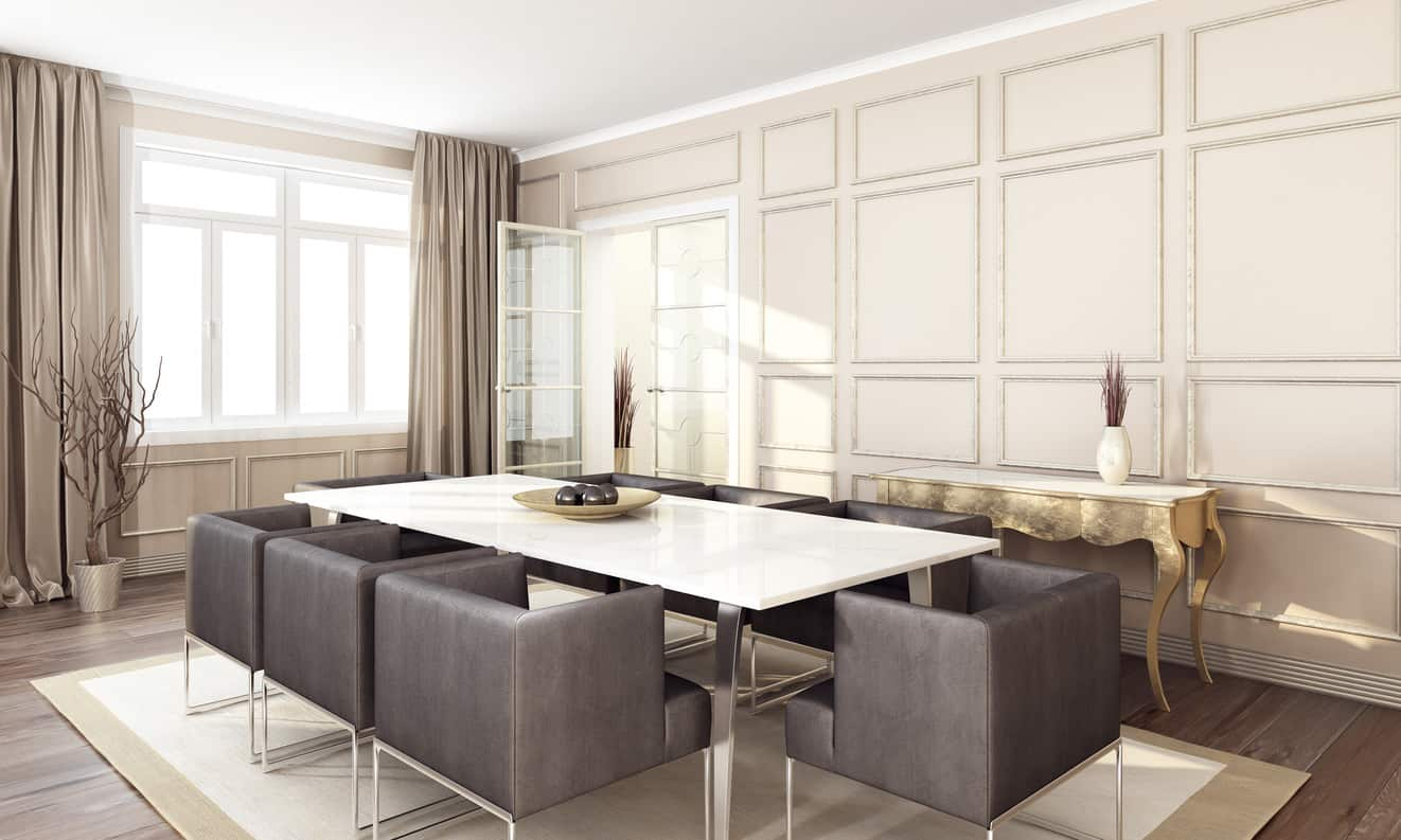 Cool modern dining room table and chairs with white panel accent wall.
