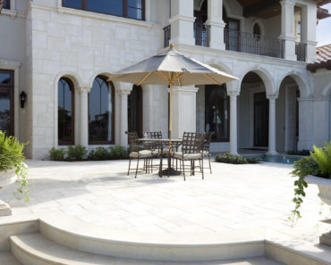 Massive luxury patio in backyard of mansion