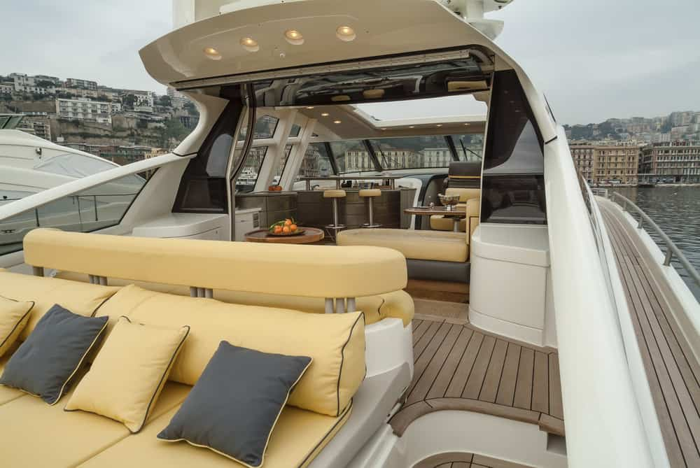Flybridge deck with reverse sofas - one looking forward and one off the rear of the yacht.