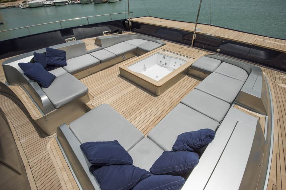 Two huge u-shaped sectional sofas on the rear deck of mega yacht.