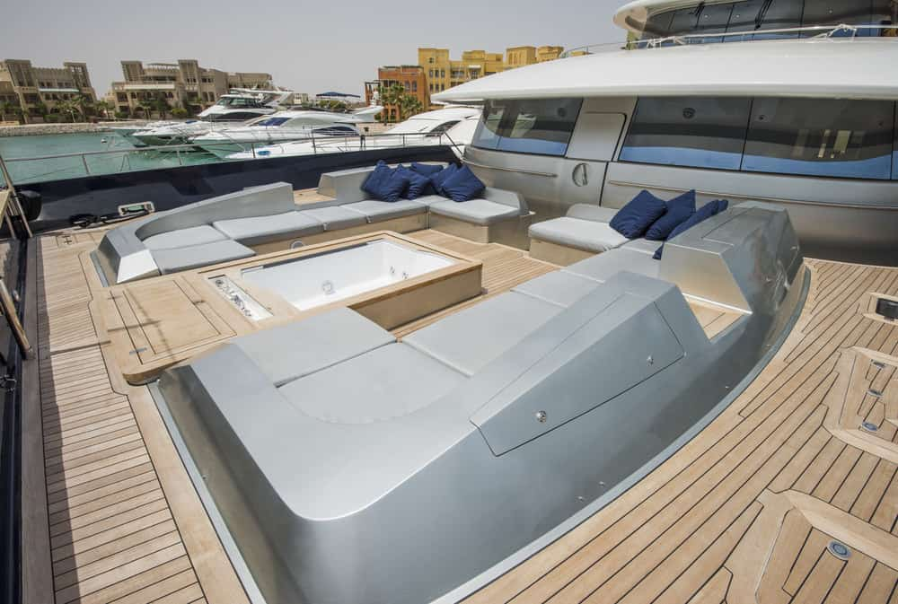 Front bow deck on luxury yacht with built in sofas and jacuzzi.