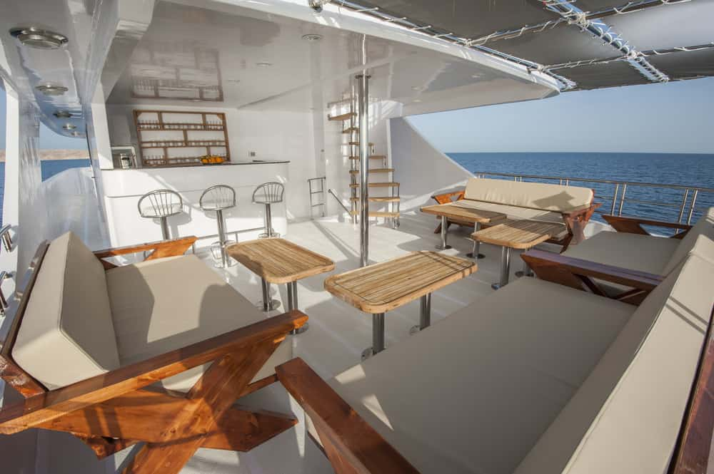 Spacious covered lower rear deck with bench seating.