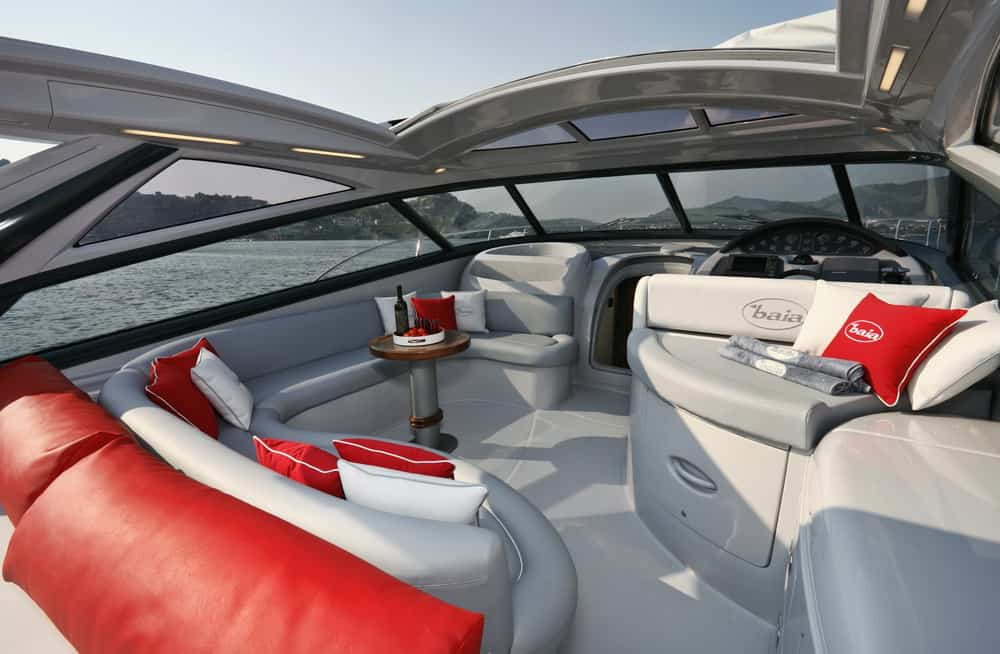 Flybridge plush seating on smaller yacht.