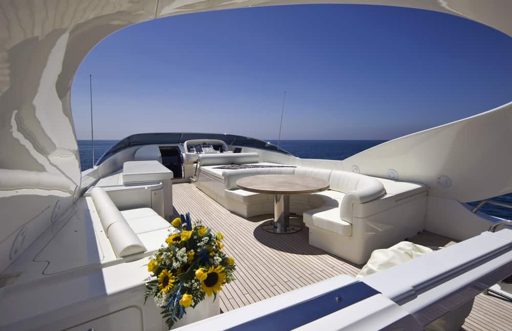 Massive lounge area on open flybridge on mega yacht.