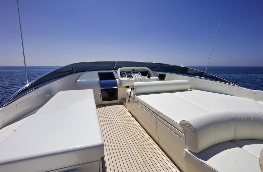 Lounge bed on open flybridge deck on yacht.