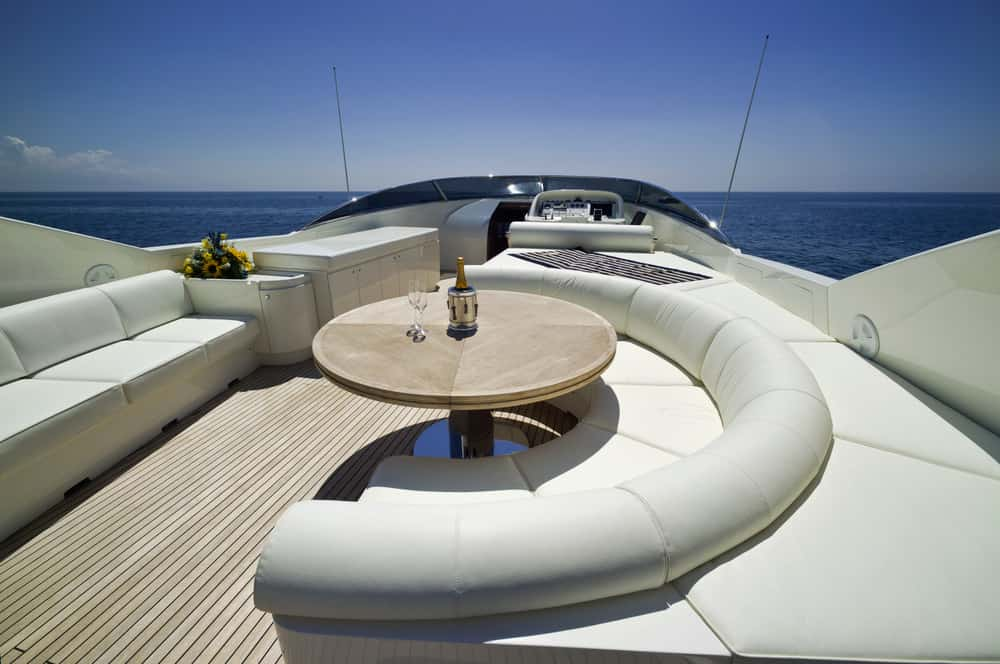 Awesome semi-circle sofa / dinette on flybridge deck of ultra luxury motor yacht.