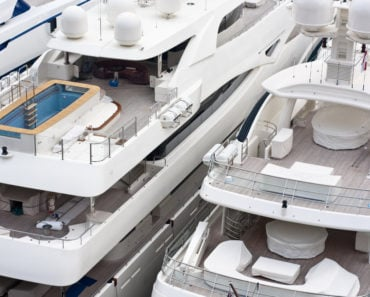 Aerial view of two luxury yacht stern and flybridge decks
