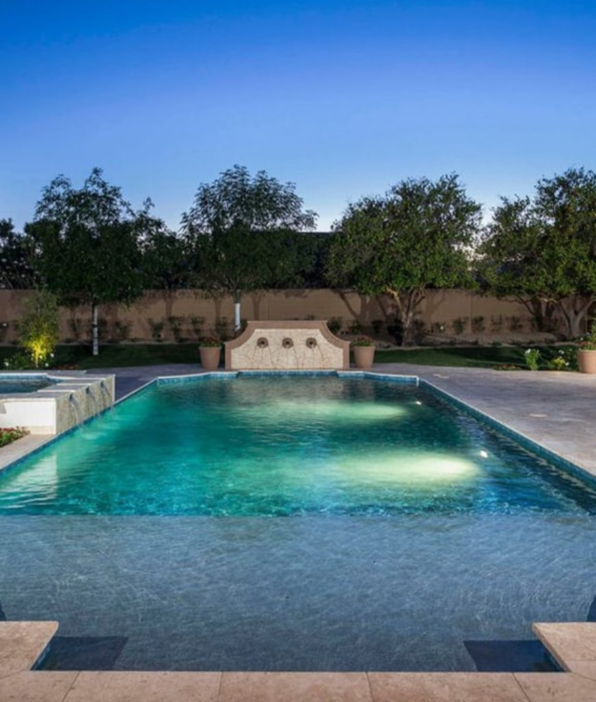 The roman-grecian style pool mirrors the Arizona skies.