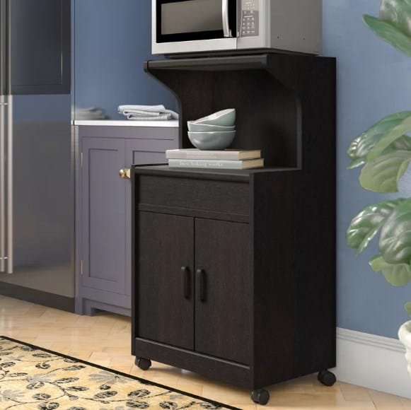 Microwave cart with shelf.