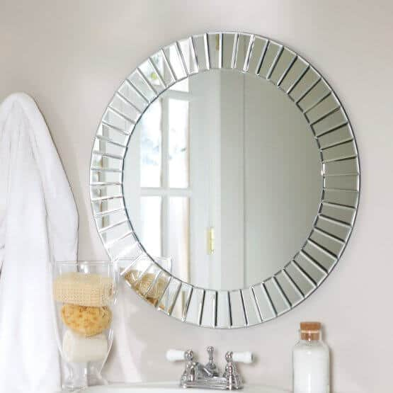 A circular mirror with a customized design.