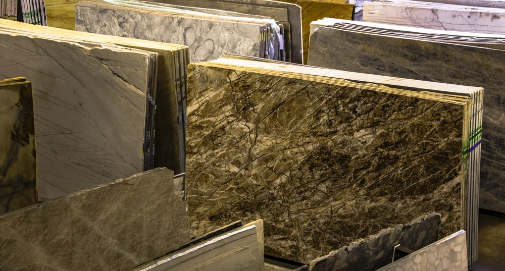 Colorful granite and marble slabs on display at a store.