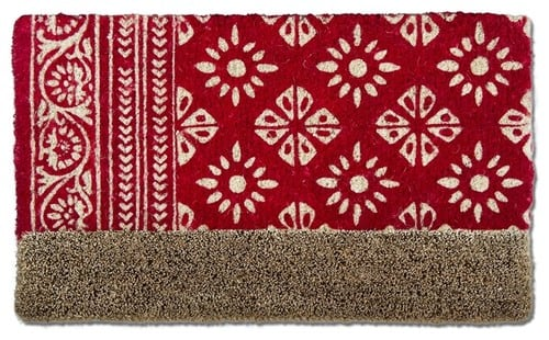 Red coir map with snowflake designs.