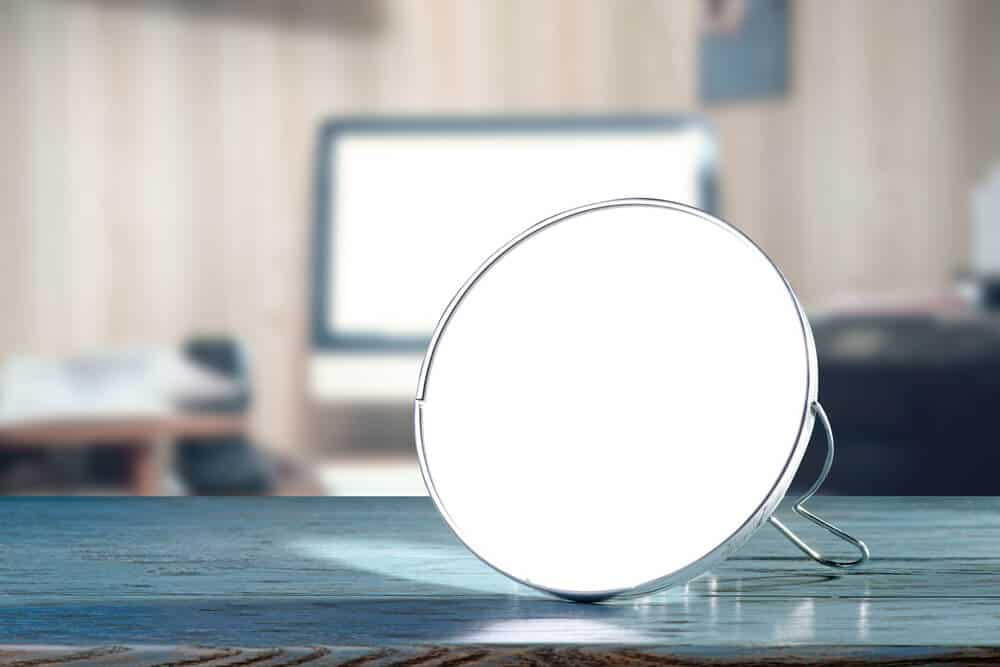 Two-way, circular mirror with a thin silver lining.