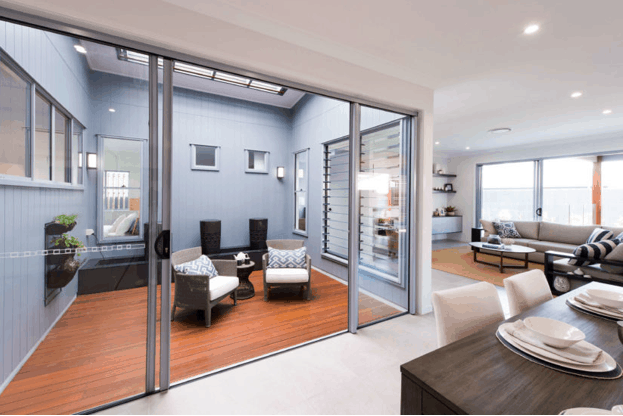 Large glass sliding door into courtyard