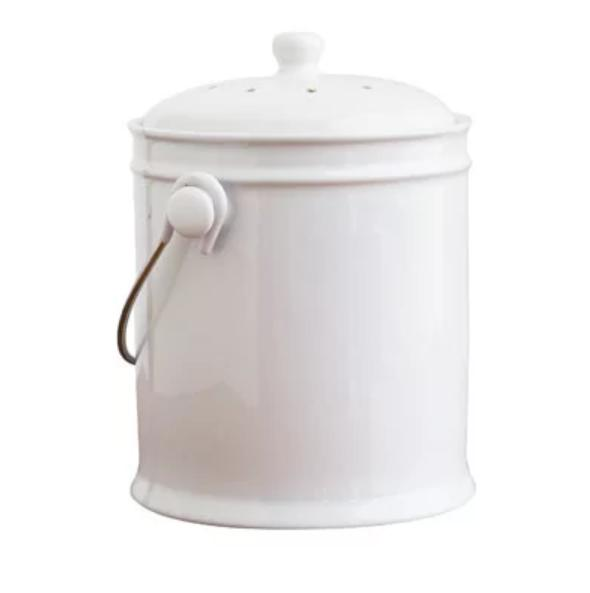 Small kitchen composter made out of white ceramics.
