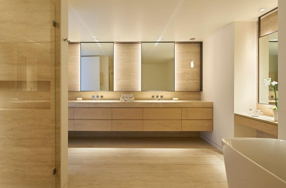 The bathroom features double sink and elegant lighting. Photo credit: Bruce Damonte