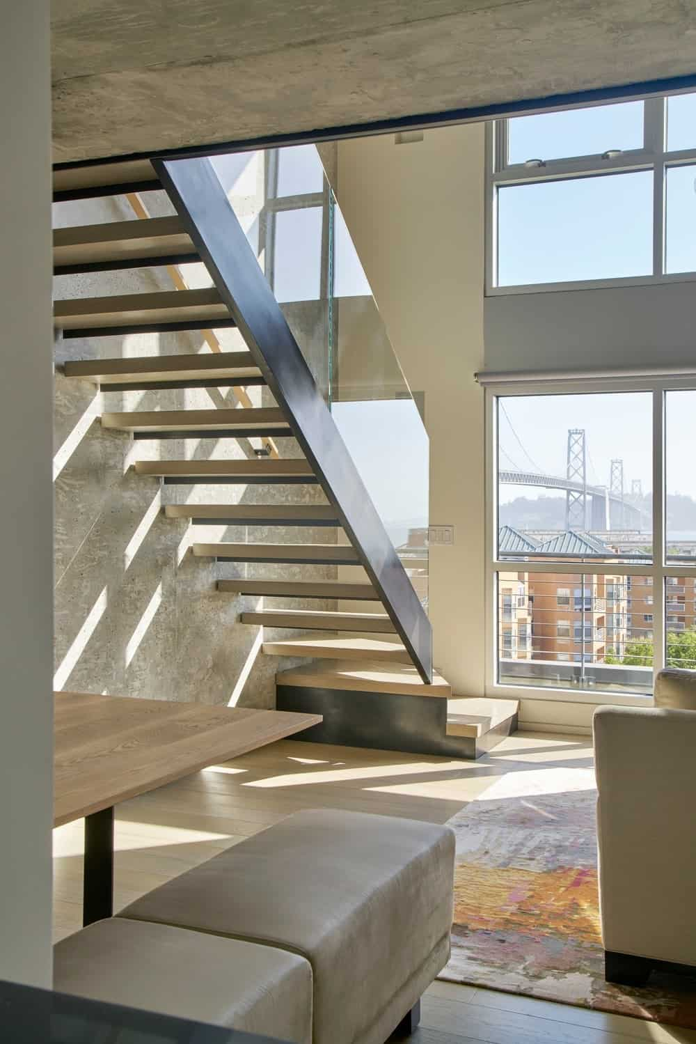 The home has a stylish staircase and glass windows. Photo credit: Bruce Damonte