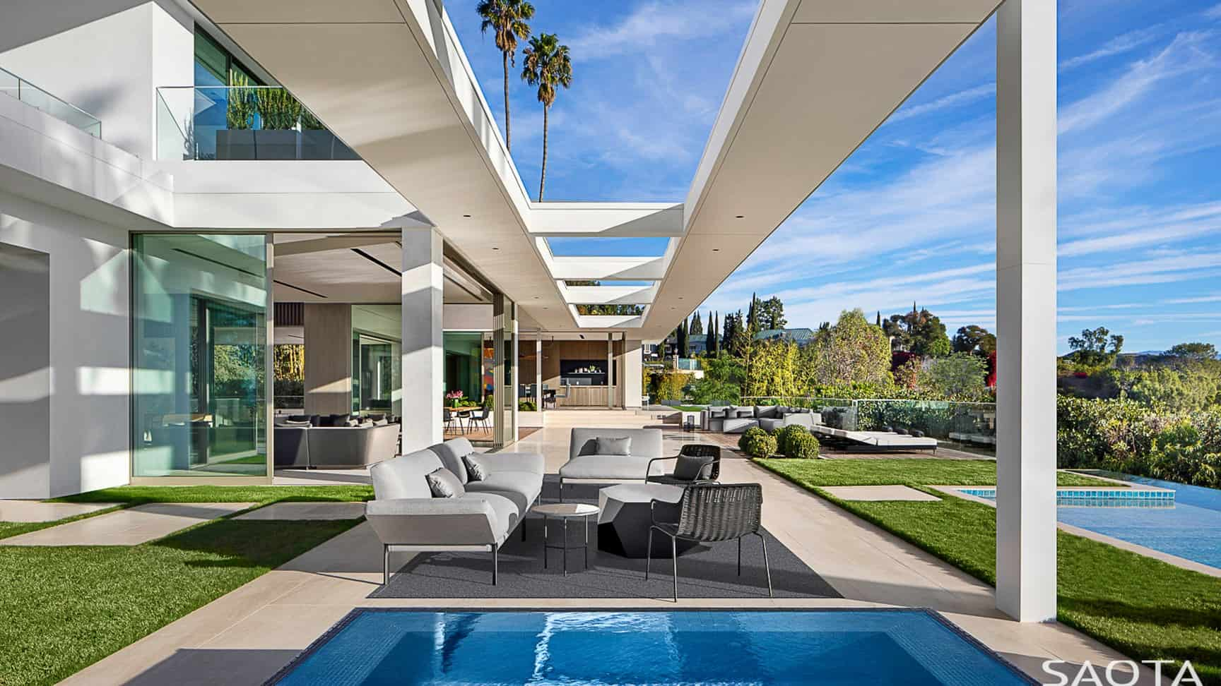 Modern house with a modish set of patio furniture. The sofa set and the table look so stylish.