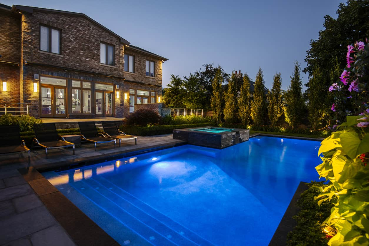Have a look at this large pool at night in alarge backyard. Simply relaxing to the eyes.