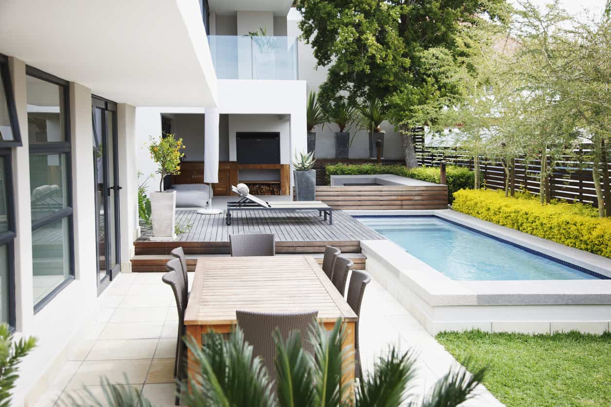Here's a view of a tiny rectangle pool in a small backyard.