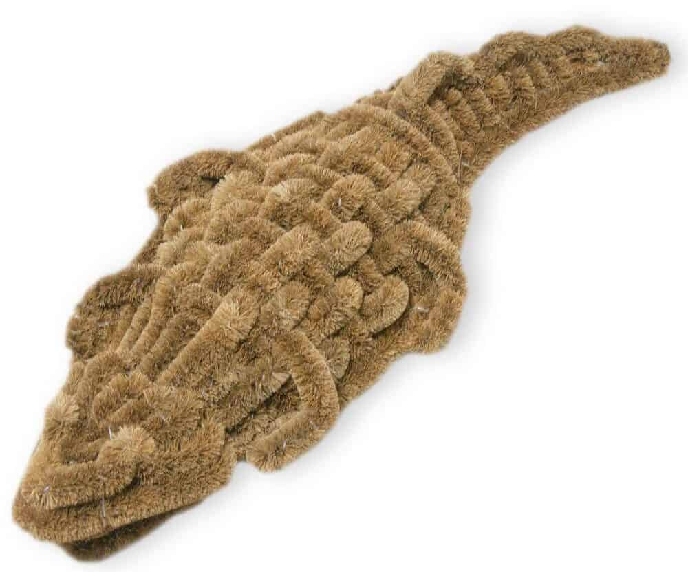 Tan-colored coir mat with an alligator-shaped finish.
