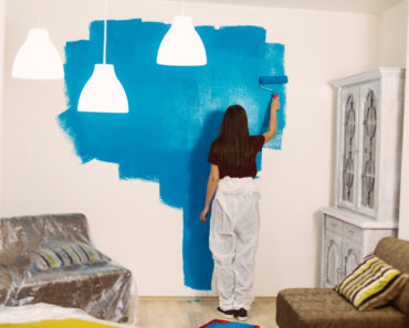 Woman painting a room