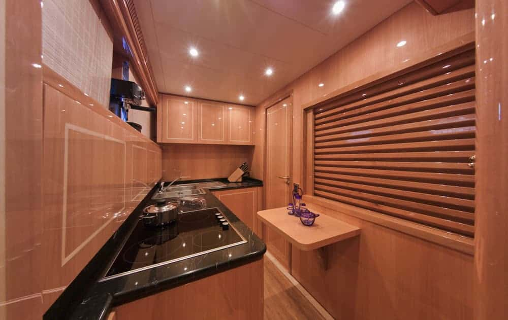 yacht kitchen area black countertop