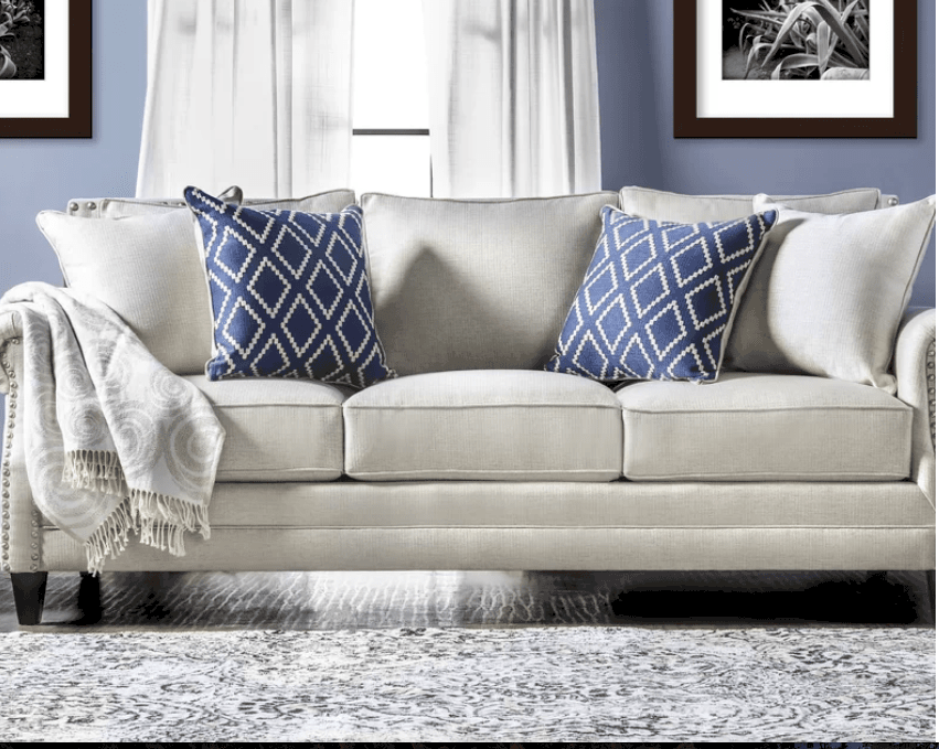 Stunning off-white overstuffed casual sofa for three people