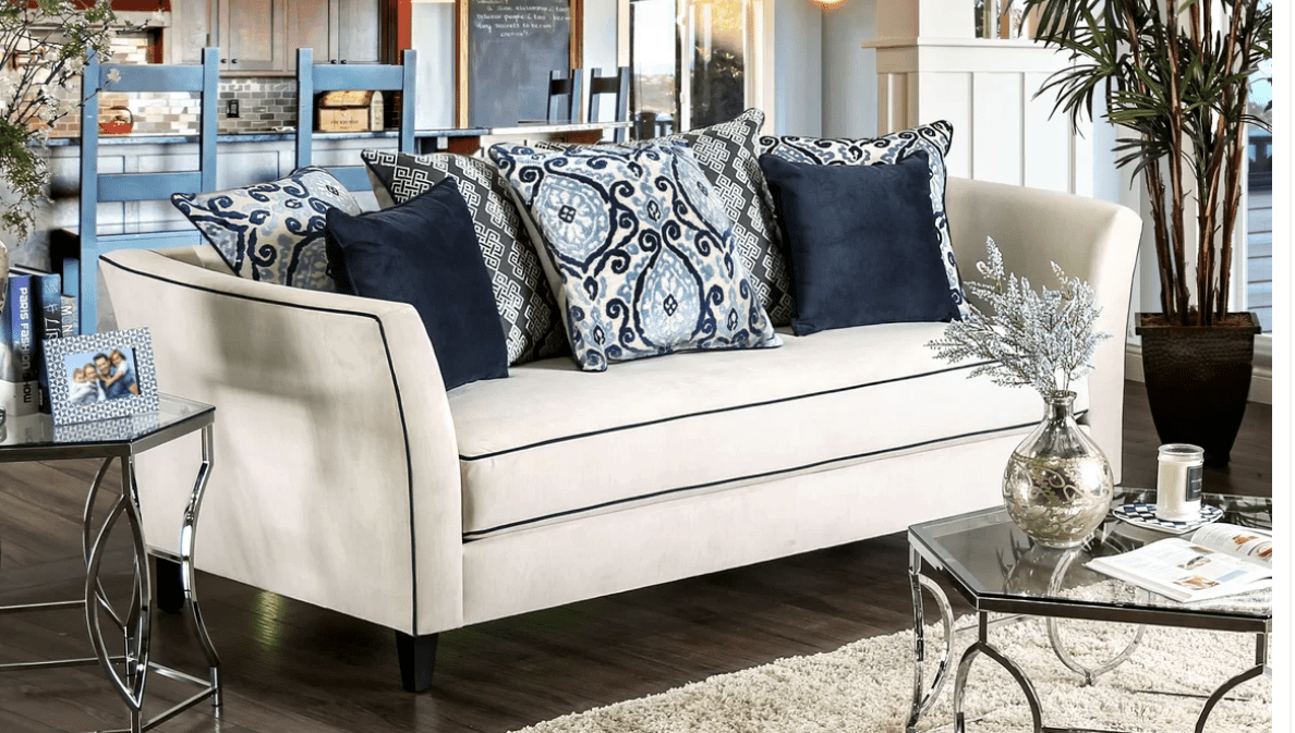 Incredible off-white sofa with dark blue outline and high arms